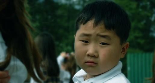 young asian boy looking at camera